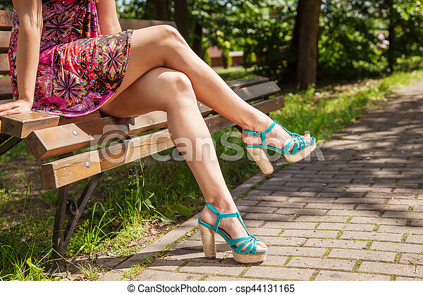 Girl Sitting On A Park Bench Young Girl In Red Dress And Green