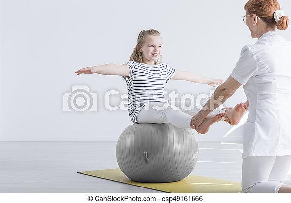 Girl sitting on gym ball - csp49161666