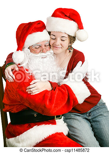 Girl Sitting on Santas Lap Getting a Hug - csp11485872