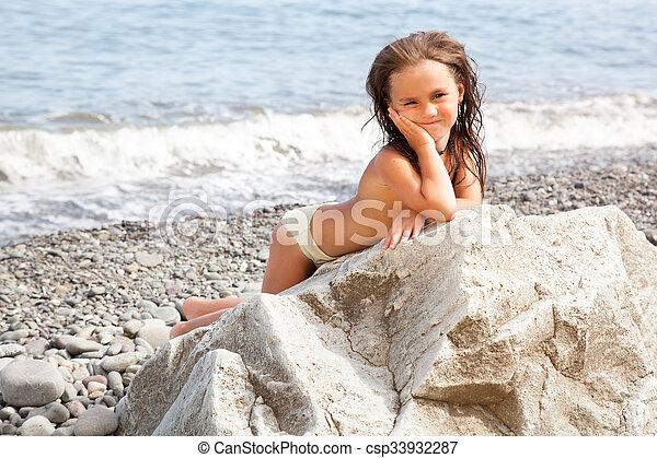 Girl sitting on the beach - csp33932287