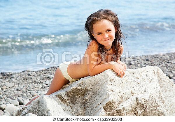 Girl sitting on the beach - csp33932308