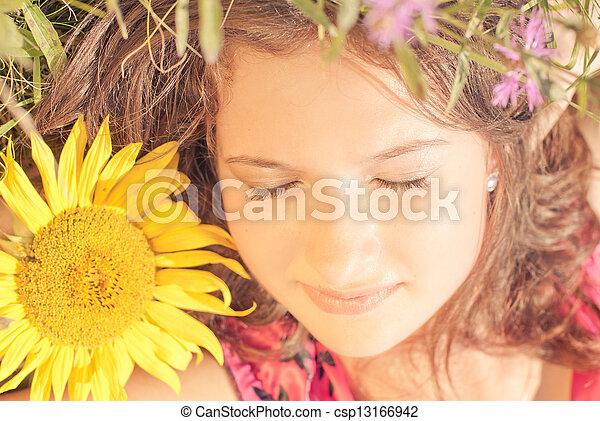 Girl sleeping among flowers - csp13166942