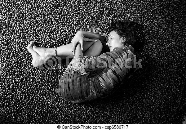 girl sleeping on a hazelnuts - csp6580717
