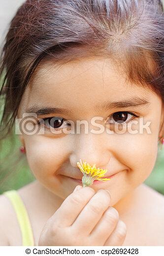 Girl smelling flower - csp2692428