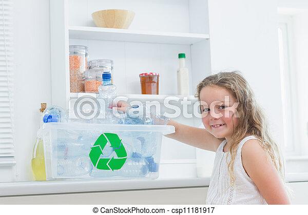 girl sorting plastics into crates smiling girl sorting plastics