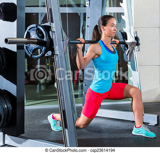 Girl squats in multipower squatting smith machine barbell ...