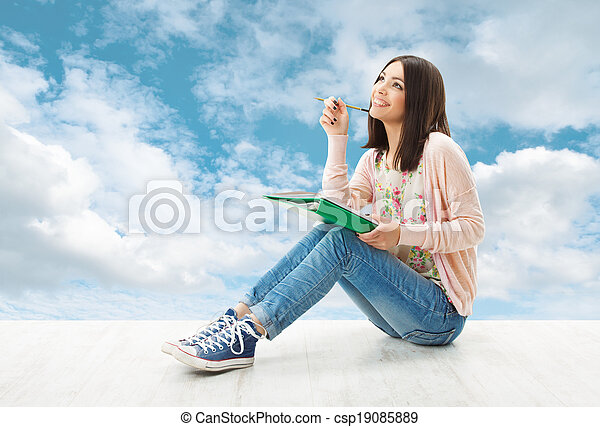 Girl teenager thinking inspiration or write idea, sitting over blue sky background - csp19085889