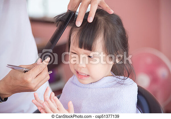 Little Asian Girl Unhappy With First Haircut By Hairdresser At Salon