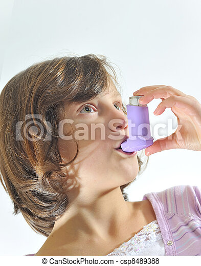 girl using an inhaler for asthma  - csp8489388