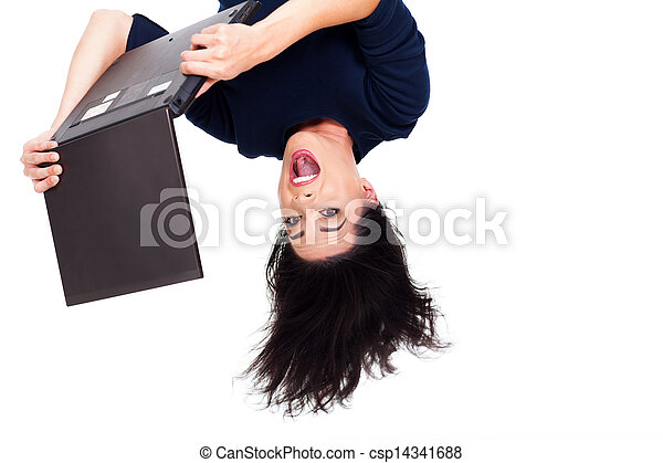 girl using laptop computer upside down - csp14341688