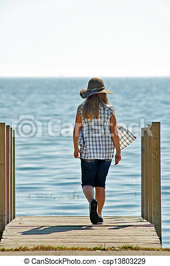 Girl Walking On Sunny Dock  - csp13803229