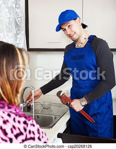 Girl watching as man repairing  - csp20268126