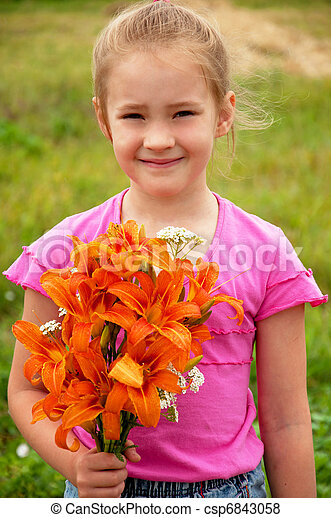 Girl with a bouquet of orange lilies  - csp6843058
