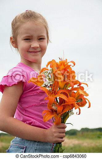 Girl with a bouquet of orange lilies  - csp6843060