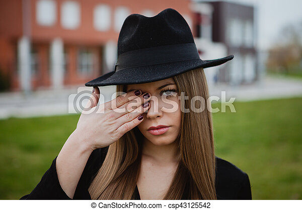af690876839 Girl with a hat covering her face with the hands. Pretty stylish ...