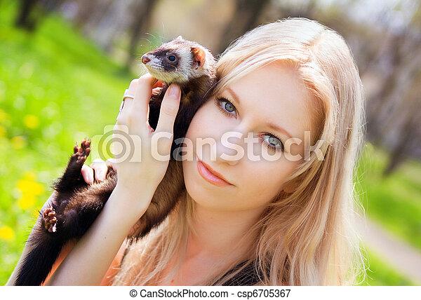 Girl with a polecat - csp6705367
