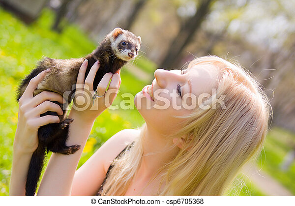 Girl with a polecat - csp6705368