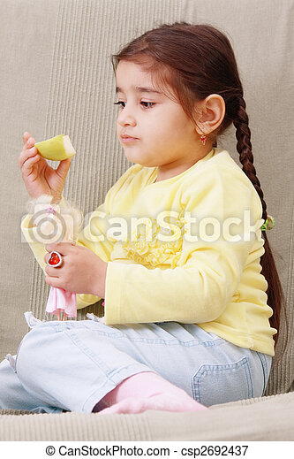 Girl with apple slice - csp2692437