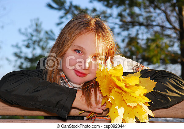 Girl with autumn leaves - csp0920441