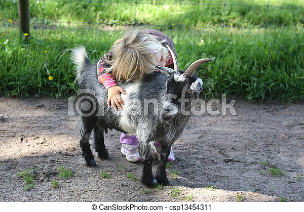 Girl with billy goat - csp13454311