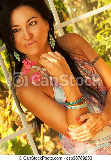 girl with flower at vacation in hotel - csp38789253
