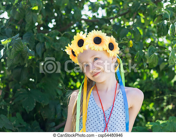 Girl with flower decoration on the head looks. - csp54480946