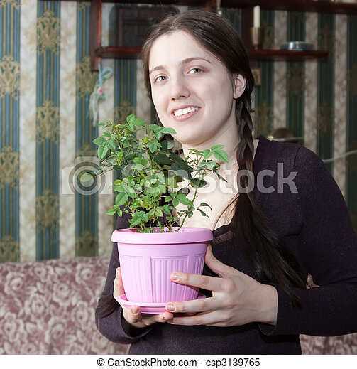 Girl with flower in the pot - csp3139765