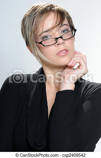 Girl with short hair and glasses