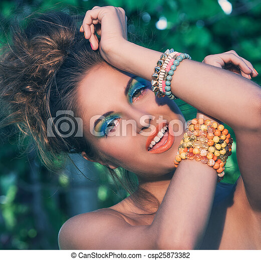 Girl with makeup and handmade bracelets - csp25873382