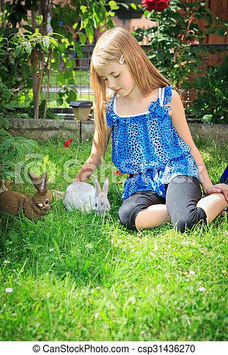 girl with rabbit - csp31436270