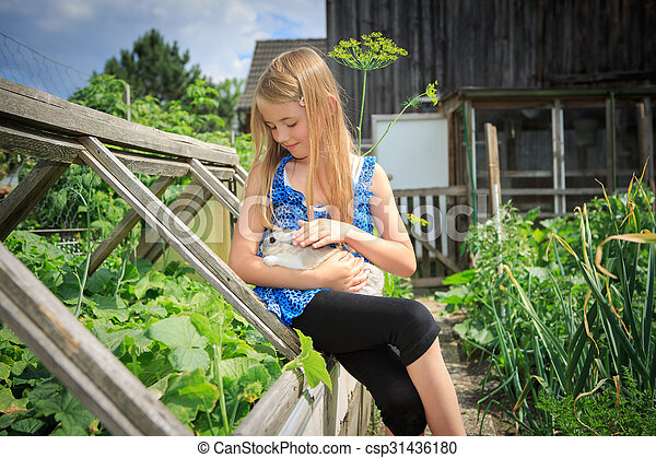 girl with rabbit - csp31436180