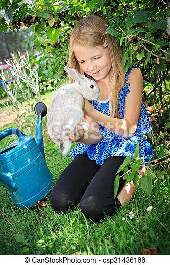 girl with rabbit - csp31436188