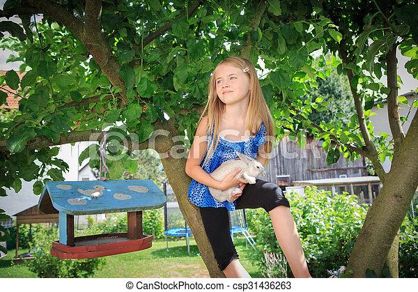 girl with rabbit - csp31436263