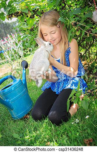 girl with rabbit - csp31436248