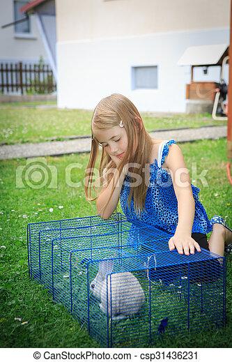 girl with rabbit - csp31436231
