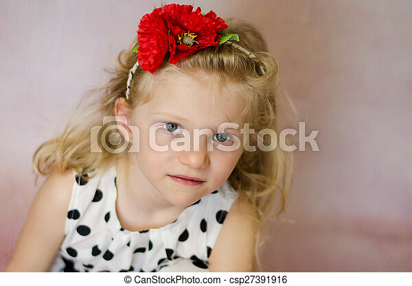 girl with red flower in hair portrait - csp27391916
