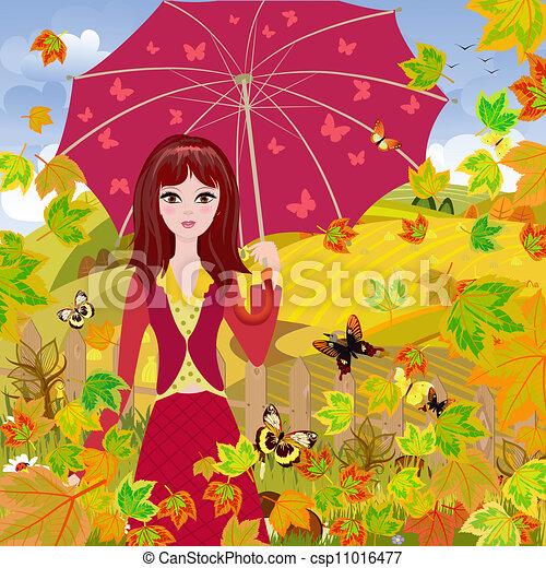 Girl with umbrella in autumn park - csp11016477