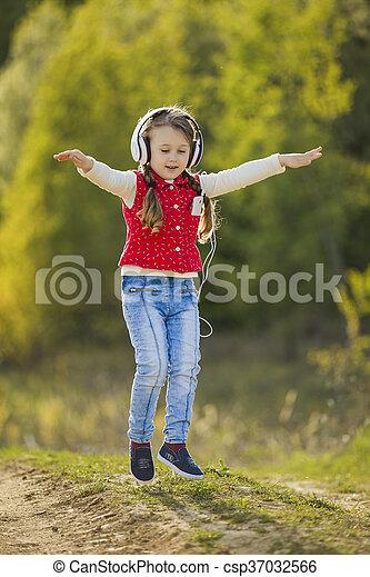 girl with white headphones - csp37032566