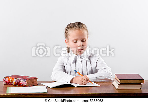 girl working on her school project - csp15365068