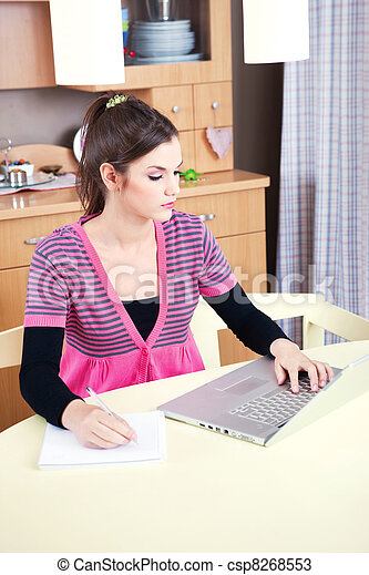 girl working on laptop at home - csp8268553