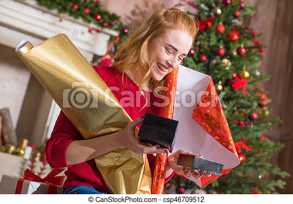 Girl wrapping gift boxes - csp46709512