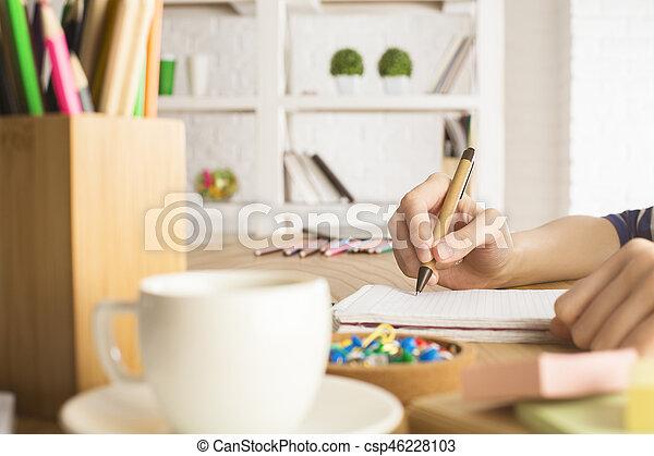 Girl writing in notepad - csp46228103