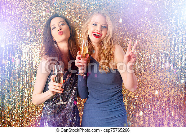 Girls drink sparkling wine to celebrate the new year - csp75765266