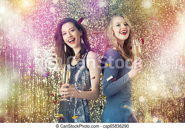 Girls drink sparkling wine to celebrate the new year - csp65836290