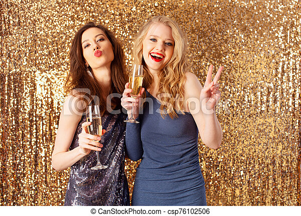 Girls drink sparkling wine to celebrate the new year - csp76102506