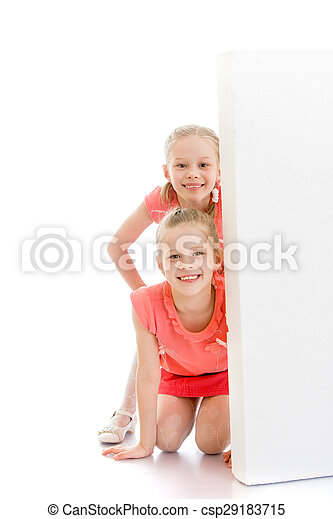 Girls look out from behind obstacles - csp29183715