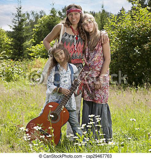 Girls of hippie in the field - csp29467763