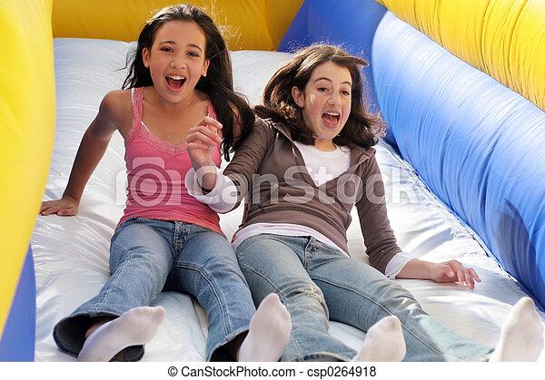 Girls on the slide - csp0264918