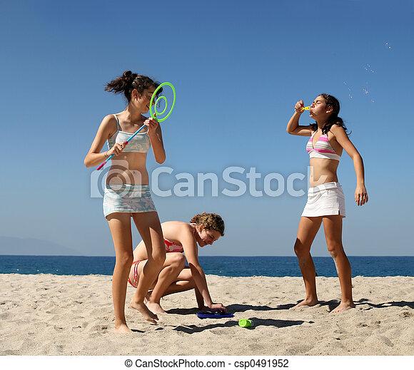 Girls playing on the beach - csp0491952