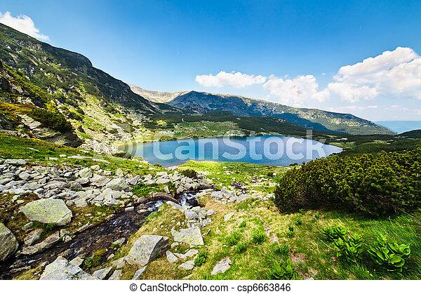 Glacial Lake Calcescu in Parang mountains, Romania - csp6663846